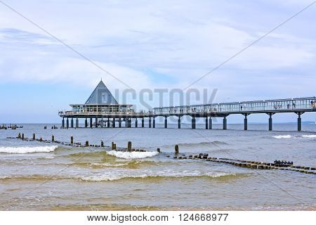 Heringsdorf, Usedom, Germany - June 27, 2012: Famous pier with restaurant building at its end. A tourist hotspot at the beach / baltic sea.