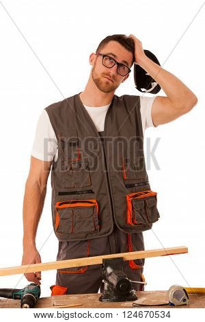 Handyman in work clothing scratching on head, looking up, thinking isolated over white.