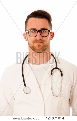 Handsome doctor in white robe with stethoscope around neck isolated over white.