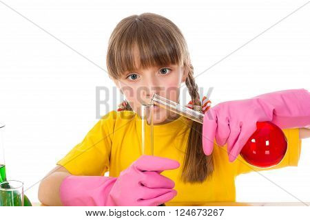 Interested girl is mixing solution. Isolated on white background