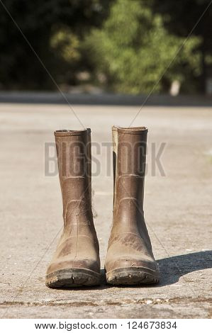 a pair of brown boots on the ground