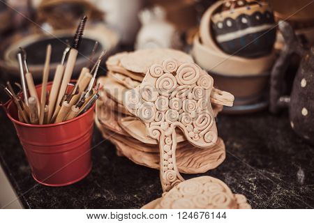 tool in pottery. Detail from pottery work room - brushes and tools