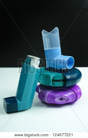 Asthma medication. Set of inhalers and medication for the treatment of bronchial asthma on a black background.