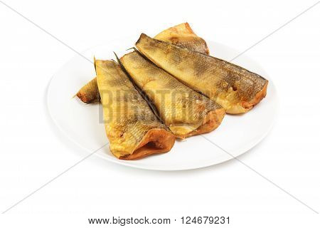 Cold smoked notothenia on plate isolated on a white background