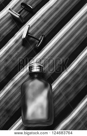 perfume with Tie and cufflinks in blackly white color