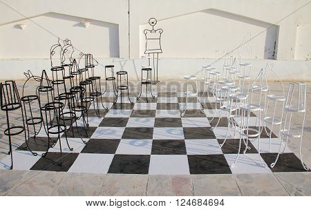 Outdoor big chess board with melal pieces