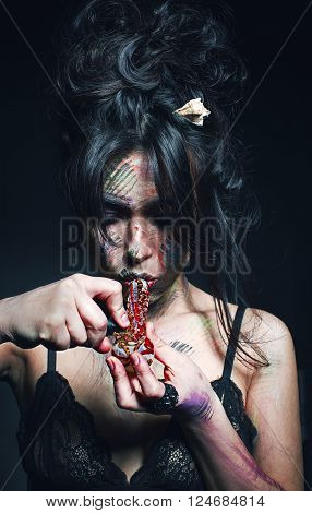 woman smokes a drug over black background