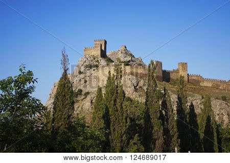 Old castle stands high in the mountains