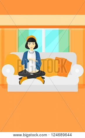Pregnant woman sitting on sofa.