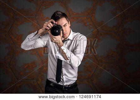 Photographer in studio like a model is makin snapshot