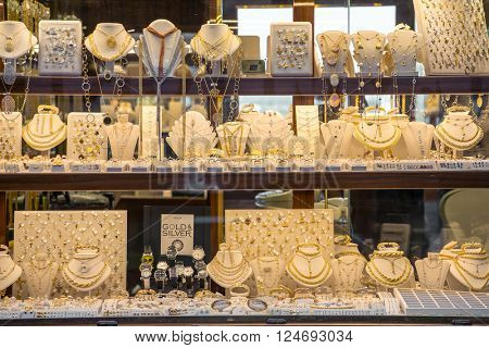 Florence, Italy - September 16, 2015: Golden jewellery in one of the jewellery shops on Ponte Vecchio bridge in Florence, Italy