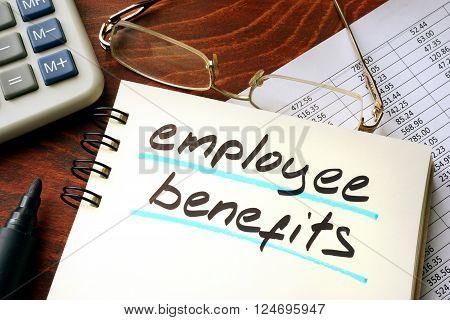 Employee benefits written on a notepad. Business concept.