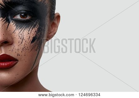 Half Face Portrait of beauty Woman with creative Makeup Art for Magazine or Advertising