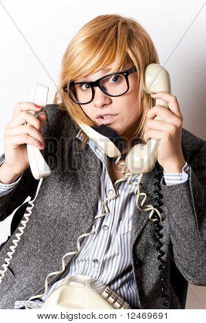 Businesswoman With Three Phones