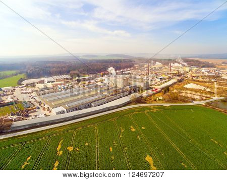 Aerial view to agricultural landscape with industrial zone near Pilsen city in Czech Republic, Europe.