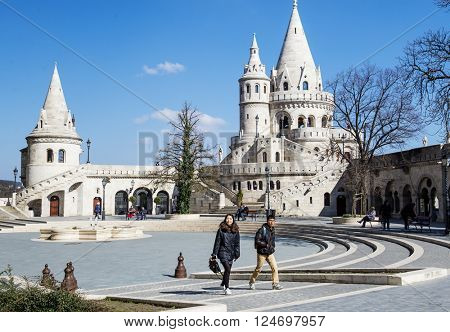 BUDAPEST, HUNGARY - MARCH 23, 2016: Tourists climbing staircase at one of the spires in the Fisherman's Bastion complex, in the Old Town district.