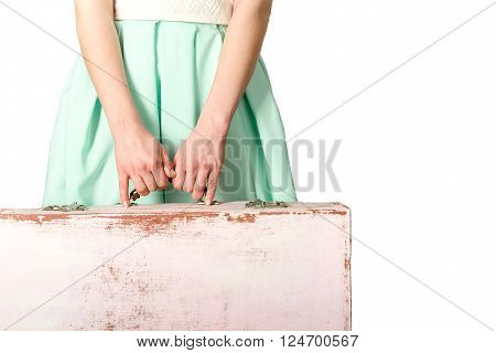 Closeup woman holding suitcase at white background. Tourism concept.