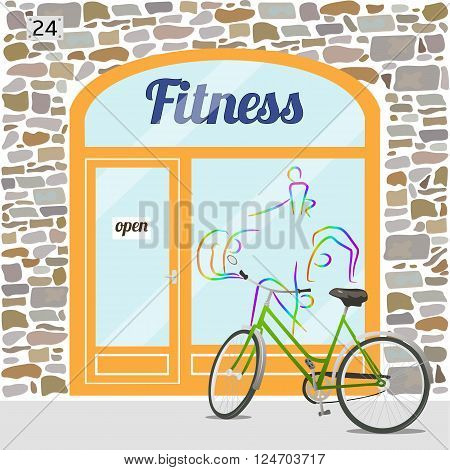 Fitness club building. Facade of stone. Fitness logo on the window. Bike at the fore. EPS10