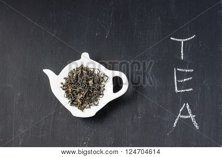 green tea leaves on a black background