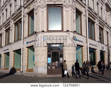 SAINT-PETERSBURG RUSSIA - MARCH 17 2015. The facade and the sign Otkrytie bank above the entrance to the office of the bank at Nevsky prospect