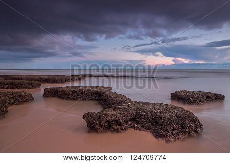 Dramatic seascape tide, stone reefs. Portugal  Albufeira beach Gale.