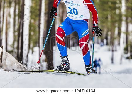 Kyshtym, Russia -  March 26, 2016: skiers athlete men up mountainl during Championship on cross country skiing