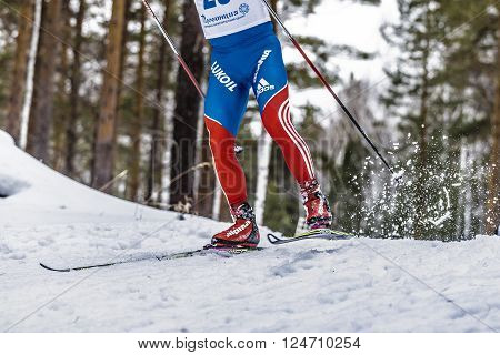 Kyshtym, Russia -  March 26, 2016: male athlete skier coming down mountain on skis during Championship on cross country skiing