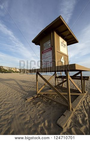 Lifeguard tower at a California beach vertical wide angle image