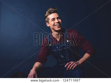 Smiling Vintage 1950S Fashion Man Wearing Jeans Bib And Brace.