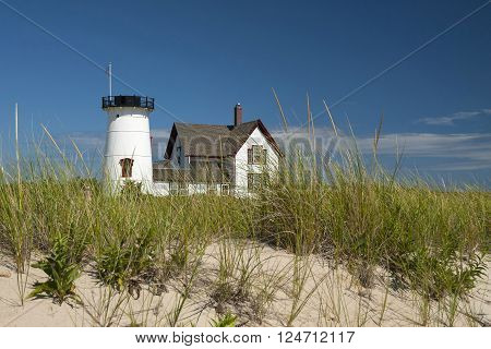 Stage Harbor lighthouse on a warm summer day is a famous Cape Cod lighthouse known for its lantern that has been removed.