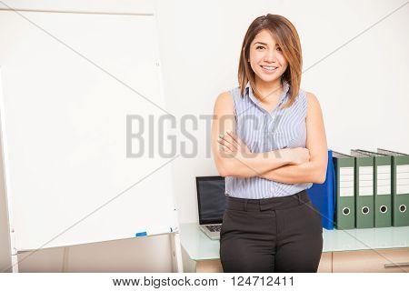 Pretty Businesswoman Giving A Presentation