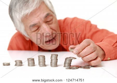 stack of coins  collapsed when man put a coin