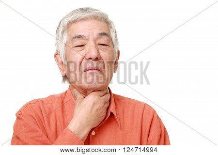 portrait of senior Japanese man having throat pain