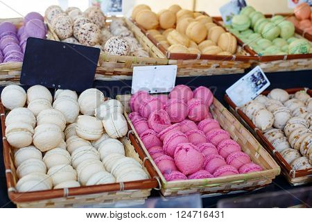 White and purple macarons, traditional sweet food in France on a farmer market in Arles, Provence.