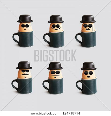 Hipster breakfast egg characters with mustache, beard, black bowler hat and glasses. Creative design holiday poster with eggs and cups. Photo with drawn gentleman faces vintage style.