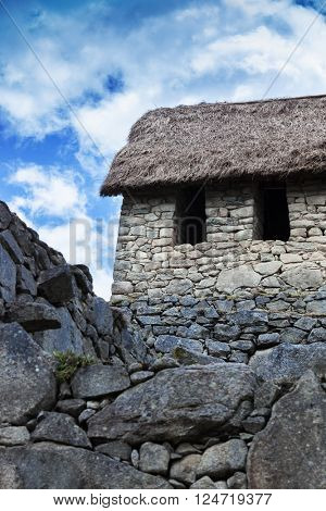 ancient stone wall and house in Machu Picchu