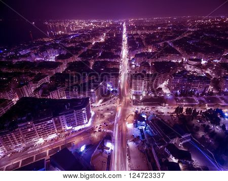 Aerial view of city Thessaloniki at night Greece. Image taken with action drone camera causing distortion and blur.
