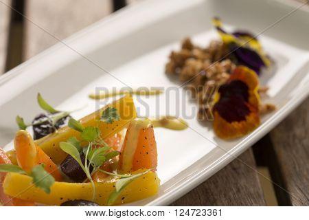 Heirloom Carrots with nasturtium crumble & saffron aioli
