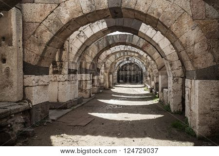 Empty Stone Corridor With Arcs And Columns