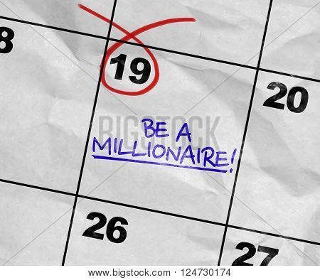 Concept image of a Calendar with the text: Be a millionaire!