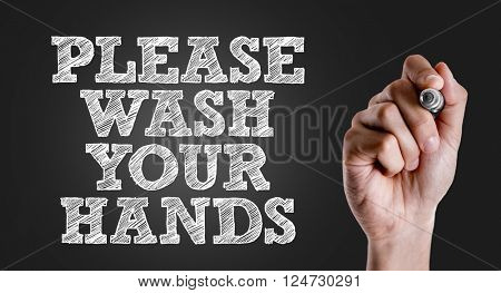 Hand writing the text: Please Wash Your Hands