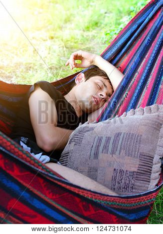 Young Man sleep in the Hammock on the Nature