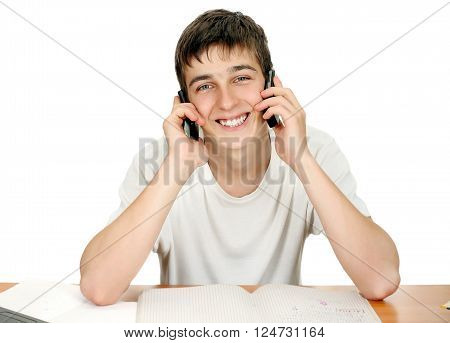 Cheerful Young Man with Two Mobile Phones Isolated on the White Background