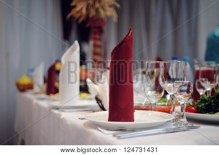 beautifully served wedding table in a restaurant.