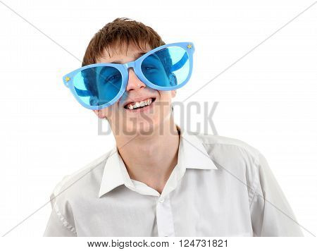 Cheerful Teenager in Big Blue Glasses Isolated on the White Background