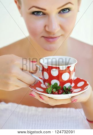 Beautiful Woman Holds The Cup Of Cowberry Tea