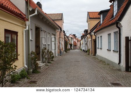 Narrow street in the historical old town in Visby, Sweden