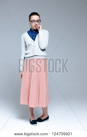 Young woman wearing stylish clothes with glasses