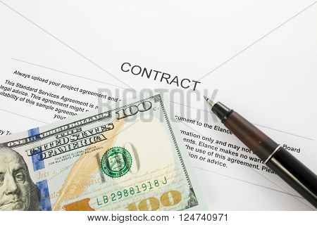Pen on the contract papers and us dollars. Business concept
