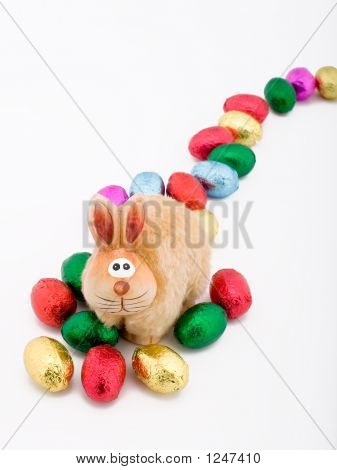 Easter Toy Rabbit With Some Choclate Eggs